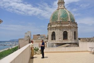 Two law professors , Cosimo Mazzoni and Fabrizio Mégale discuss inn front of the Church of Purgatory, in Trapani