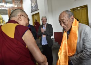 His Holiness theDalai Lama with Lama and Richard Gere i the background