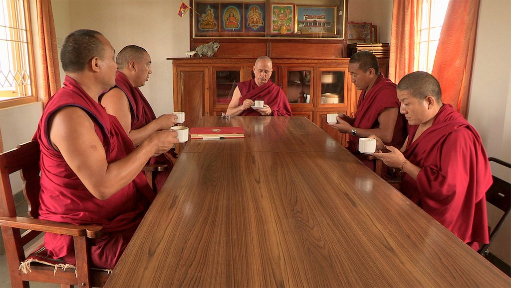 At the beginning of the film, he sips tea (or hot water?) and he is the only monk to have a soucoupe under his cup!
