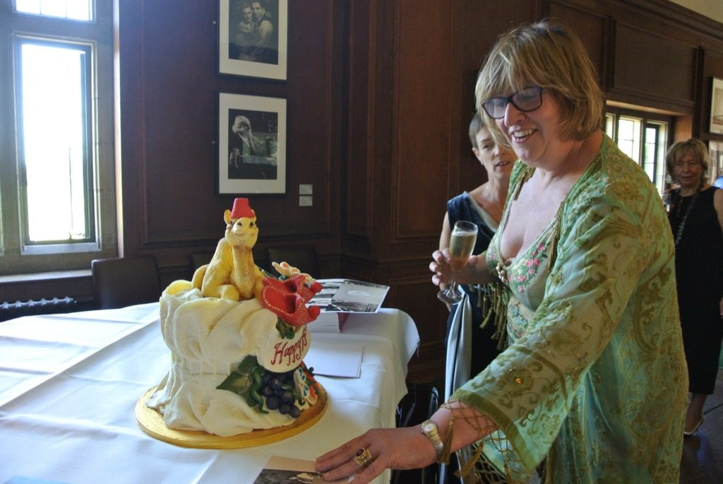 The birthday girl with a cake in shape of a camel