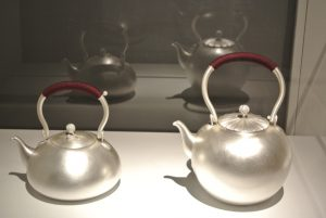 Silver tea pots with string handle