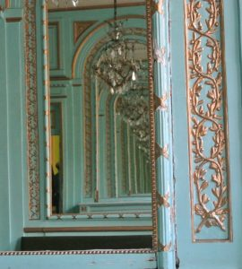 IN the XVIII th century salon, mirrors play with wood decoration