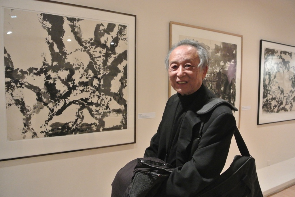 Nobel Prize winner and friend Dao in front of an ink by Zao Wou Ki