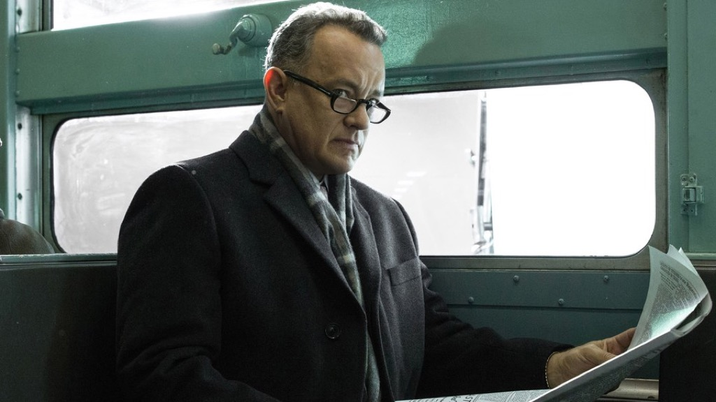 Tom Hanks becomes a national heroe and the future adviser to Kennedy for the Cuban release of the Bay of Pigs prisoners