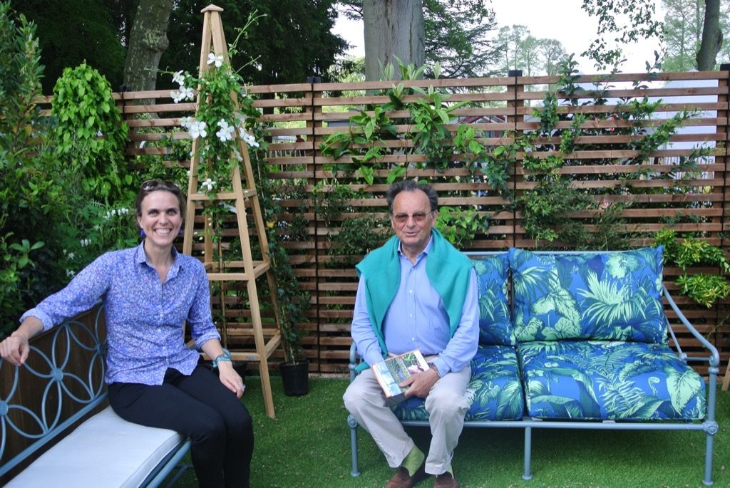 Blanche Aloisi de Crépy and Arnaud Brunel sitting on the new Madeleine Castaing benches by Tectona