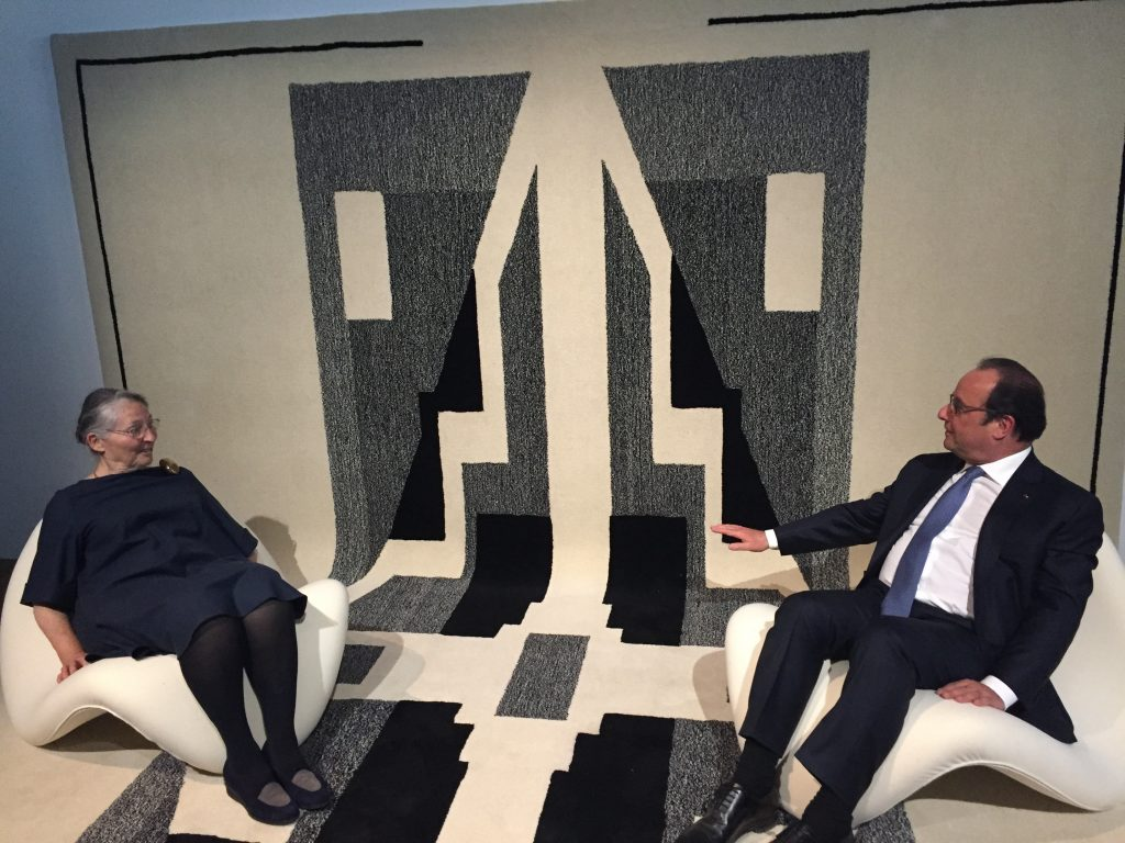 Maïa Paulin and Presdient François Hollande sitting by the Diwan carpet