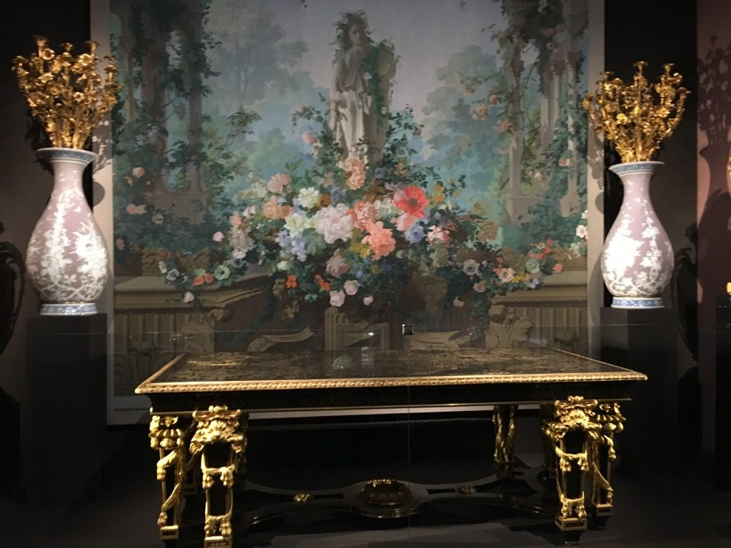 """Table in the Louis XIV style, 1867, in front of wallpaper """"Le Jardin d'Armide"""" by Edouard Muller, 1854"""