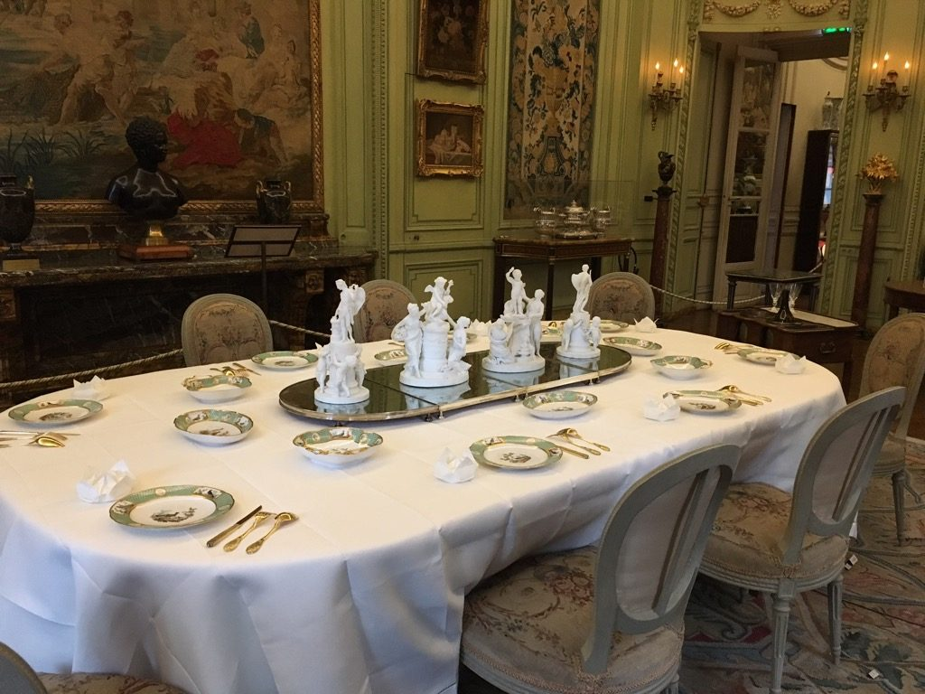 The table set for ten in the dinging room with central Sèvres biscuit statues