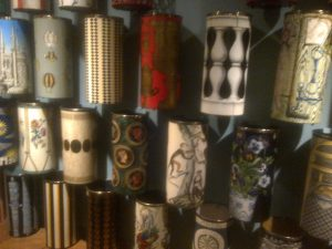 the umbrella stands were all hanging on the wall