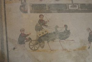 Children drive their carts pulled by birds in the mosaics of Villa Romana del Casale