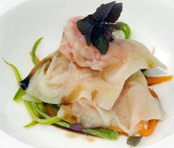Transparent shrimp raviolis are prepared by a Japanese chef
