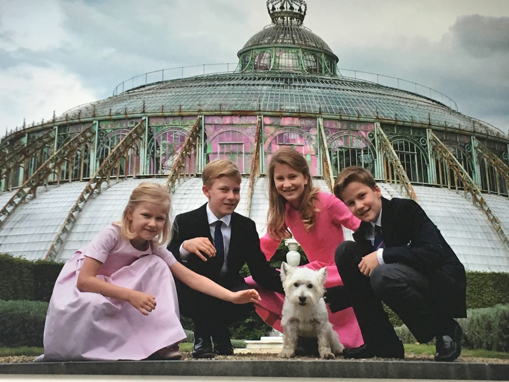 A picture of the royal children in front of the first and most majestuous green house