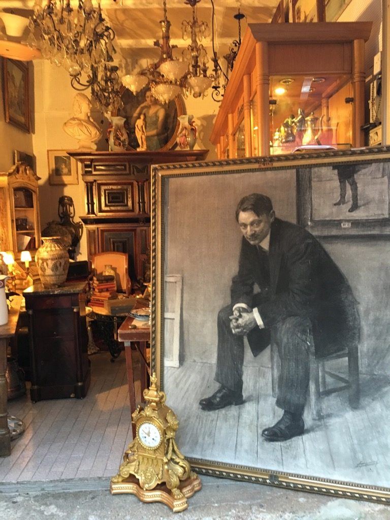 A nice portrait, lamps, furniture, the epitome of the flea market