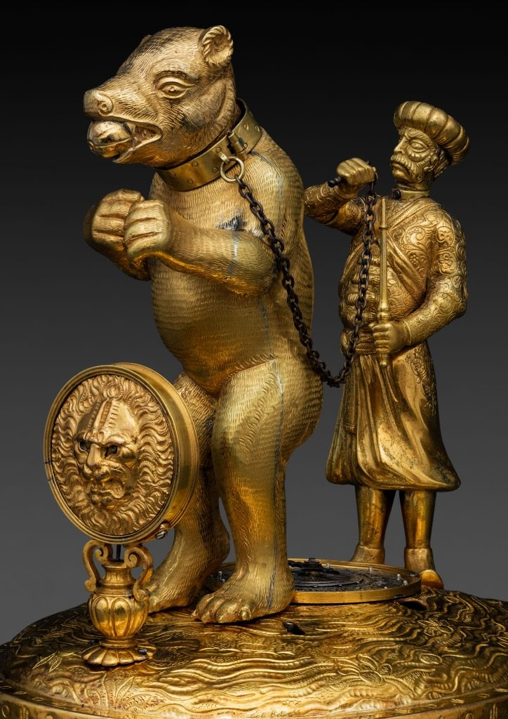 A bear with his master, gilt bronze